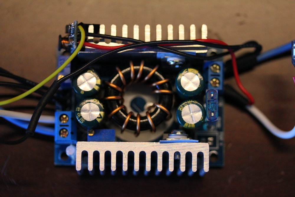 Top view of the boost converter board. On the right I tapped the battery voltage with the small red and black wires for the 12V buck converter. The buck board is mounted on the top left.